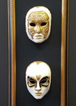two framed masks